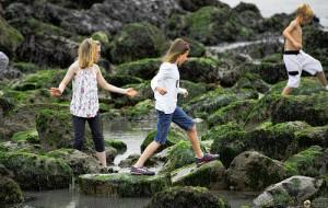 Children climbing over rocks